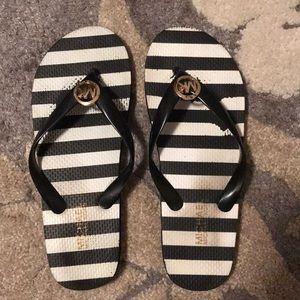 Michael Korda flip flops